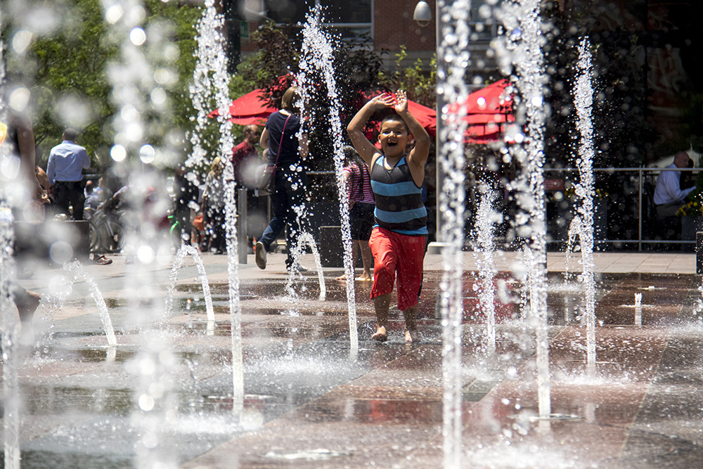 Elias plays in Union Station's fountains. (Kevin J. Beaty/Denverite)  summer; cowx; weather; union station; swimming; denver; denverite; colorado; kevinjbeaty