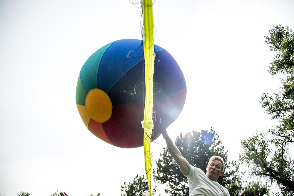Kyle Scholtz smacks a giant volleyball in City Park. (Kevin J. Beaty/Denverite)  denver; colorado; city park; summer; volleyball; lawn sports; kevinjbeaty; denverite;