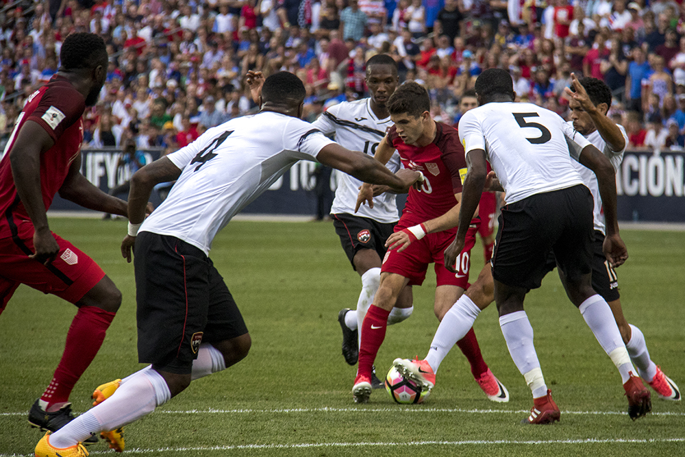 Christian Pulisic tries to chase the ball away from four ensuing opponents. The U.S. men's national soccer team vs Trinidad and Tobago, Dick's Sporting Goods Park, June 8, 2017. (Kevin J. Beaty/Denverite)  soccer; fifa; world cup; sports; kevinjbeaty; denver; denverite; colorado;