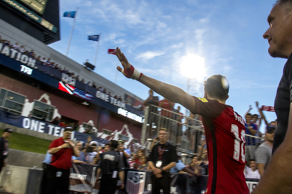 Christian Pulisic. reaches to fans as he exits the field. The U.S. men's national soccer team vs Trinidad and Tobago, Dick's Sporting Goods Park, June 8, 2017. (Kevin J. Beaty/Denverite)  soccer; fifa; world cup; sports; kevinjbeaty; denver; denverite; colorado;