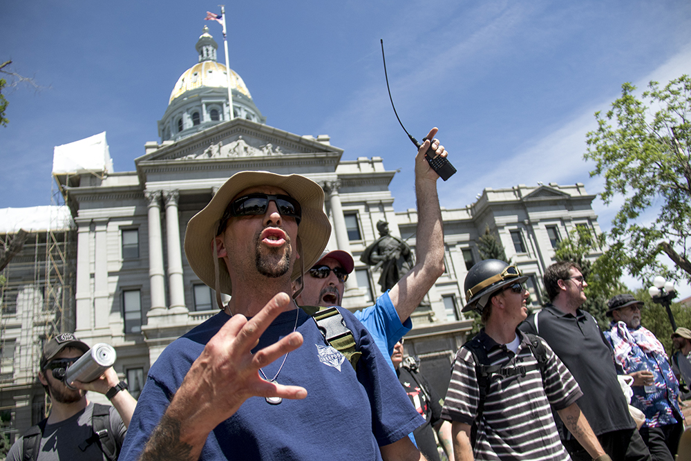 Zach Debiore hollers at the start of a rally against Sharia law atop the Capitol steps, June 10, 2017. (Kevin J. Beaty/Denverite)  copolitics; rally; protest; sharia law; islamophobia; kevinjbeaty; denver; colorado; denverite;