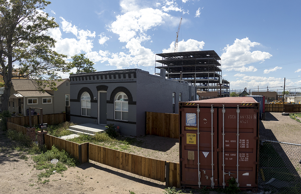 Brighton Boulevard development seen behind residences on Wynkoop Street, Five Points, June 14, 2017. (Kevin J. Beaty/Denverite)  Giambrocco; rino; five points; development; commercial real estate; construction; kevinjbeaty; denver; colorado; denverite; residential real estate;