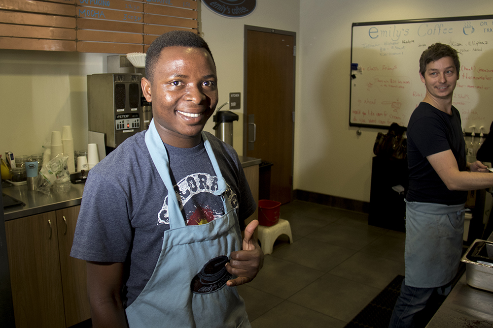 Lead trainer and manager Kristopher Rainer instructs Eliphaz Kenge, a refugee from the Democratic Republic of Congo, at Emily's Coffee inside the Emily Griffith Technical College, June 15, 2017. (Kevin J. Beaty/Denverite)  Emily Griffith Technical College; north capitol hill; refugee; coffee shop; kevinjbeaty; denver; denverite; colorado;