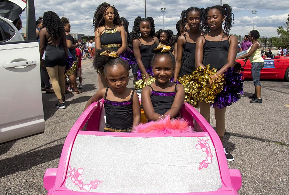 Azatiy and Teaionna ride in a pink Escallade. The Juneteenth parade in Five Points, June 17, 2017. (Kevin J. Beaty/Denverite)  juneteenth; five points; black history; kevinjbeaty; denver; colorado; denverite; street fair; festival; welton street;