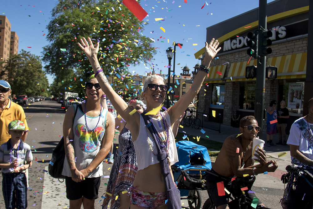 Kristen Ulesoo is showered with confetti during the parade. Denver PrideFest, June 18, 2017. (Kevin J. Beaty/Denverite)