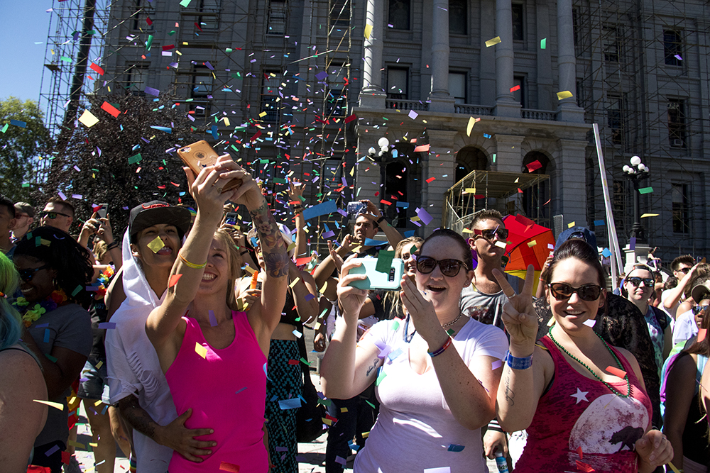 The crowd is showered by confetti in front of the State Capitol. Denver PrideFest, June 18, 2017. (Kevin J. Beaty/Denverite)