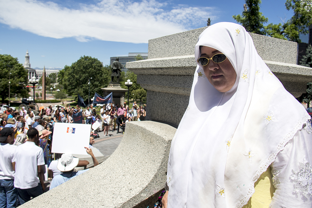 Fatemeh Shamsuddini, a refugee from Afghanistan, stands on the Capitol steps on World Refugee Day, June 20, 2017. (Kevin J. Beaty/Denverite)
