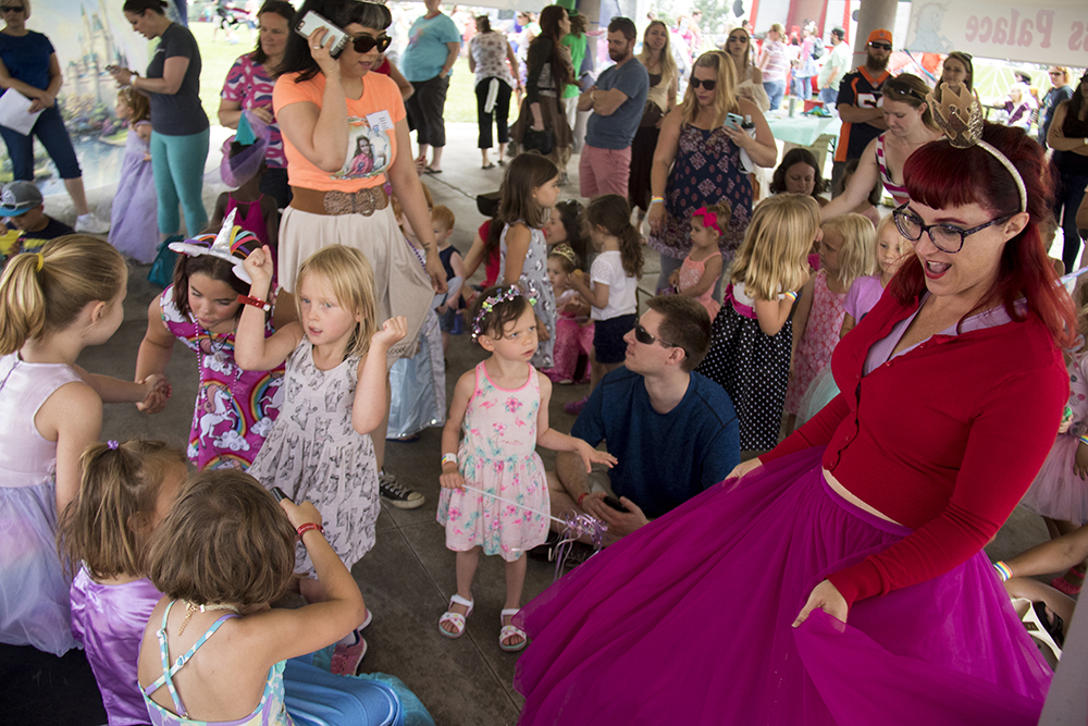 """Princess Squeaky dances with a bunch of smaller princesses in the """"princess palace."""" The first-annual Unicorn Festival in Clement Park, Littleton. (Kevin J. Beaty/Denverite)colorado; kevinjbeaty; unicorn festival; denverite; littleton; whimsy; summer;"""