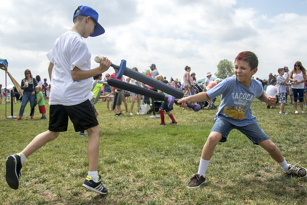 Aiden (left) and Soren battle in the sword ring. The first-annual Unicorn Festival in Clement Park, Littleton. (Kevin J. Beaty/Denverite)colorado; kevinjbeaty; unicorn festival; denverite; littleton; whimsy; summer;