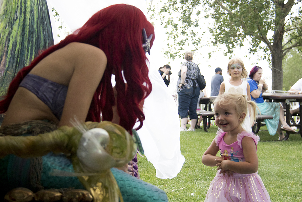 Young Paisley meets Ariel the mermaid. The first-annual Unicorn Festival in Clement Park, Littleton. (Kevin J. Beaty/Denverite)  colorado; kevinjbeaty; unicorn festival; denverite; littleton; whimsy; summer;