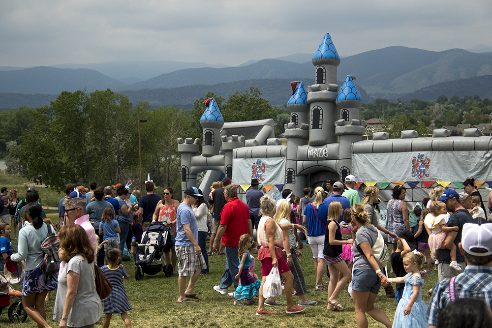 A castle was inflated on the horizon. The first-annual Unicorn Festival in Clement Park, Littleton. (Kevin J. Beaty/Denverite)colorado; kevinjbeaty; unicorn festival; denverite; littleton; whimsy; summer;