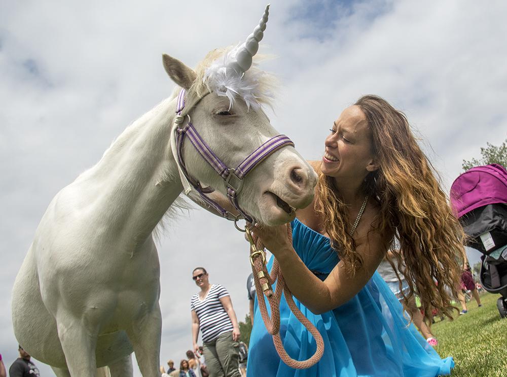 Princess Traci Johnson and Diamond the mini unicorn. The first-annual Unicorn Festival in Clement Park, Littleton. (Kevin J. Beaty/Denverite)  colorado; kevinjbeaty; unicorn festival; denverite; littleton; whimsy; summer;