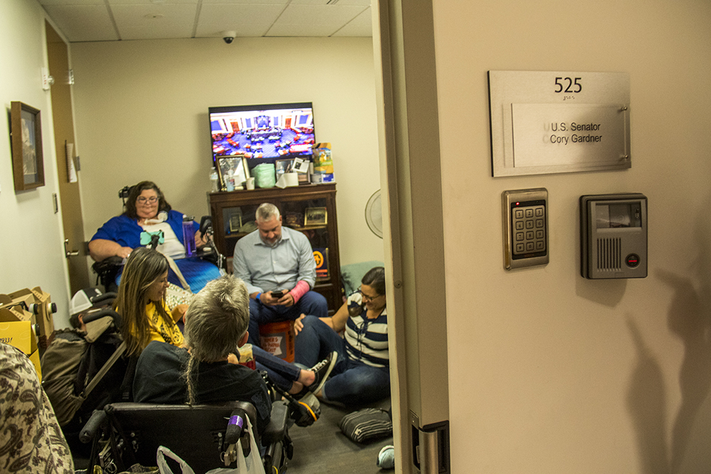 A sit-in at Senator Cory Gardner's office opposing a Republican healthcare plan, June 28, 2017. (Kevin J. Beaty/Denverite)  denverite; protest; cory gardner; sit in; civil disobedience; healthcare; medicaid; kevinjbeaty; denver; colorado;