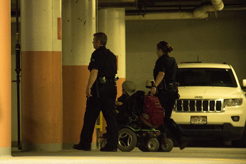 Kalyn Heffernan is escorted to a police van. (Kevin J. Beaty/Denverite)