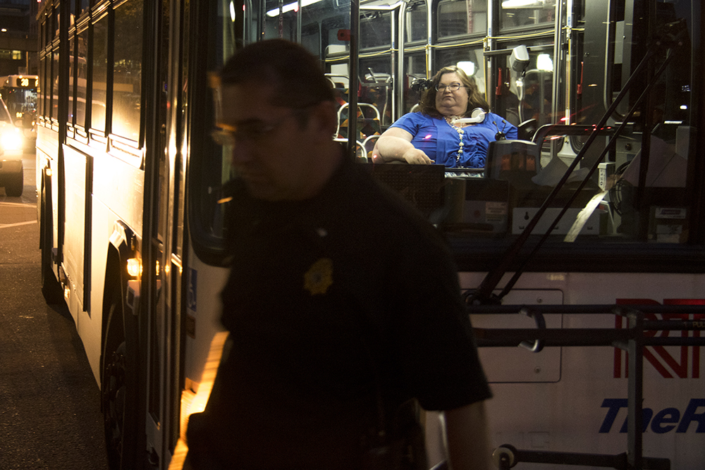 Carrie Ann Lucas is the last protester led out of the building by police. She boarded an RTD bus that left with a patrol car as an escort.