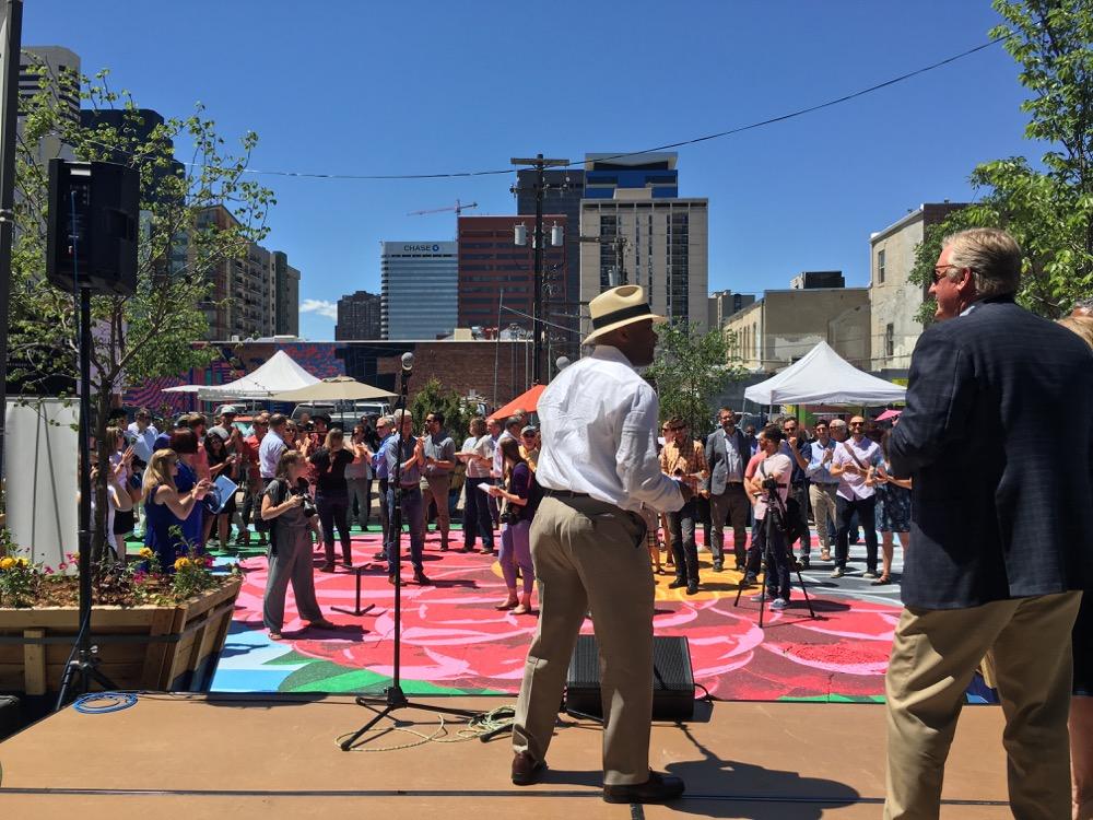 Mayor Michael Hancock speaks at the opening of Square on 21st. (Andrew Kenney/Denverite)