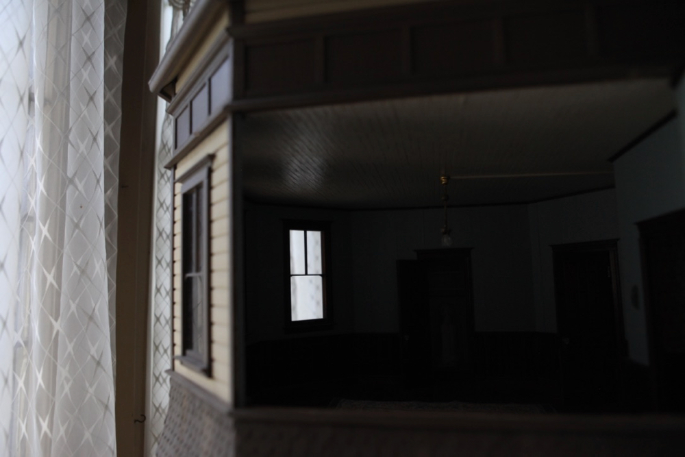 A dollhouse window with a view of the real thing. (Andrew Kenney/Denverite)