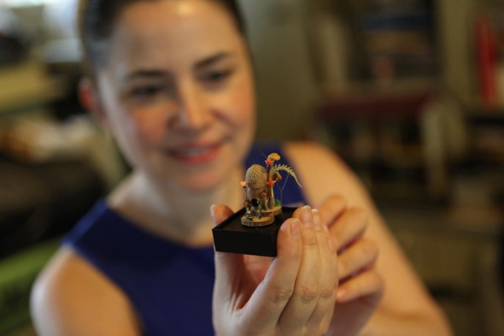 Wendy Littlepage shows off a festooned acorn. (Andrew Kenney/Denverite)