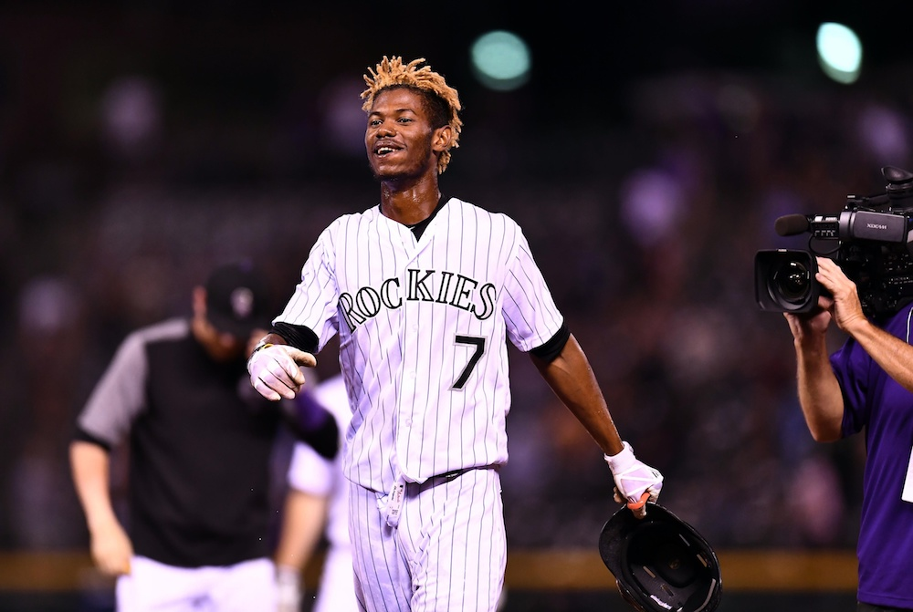 Raimel Tapia's ninth-inning RBI preserved a Rockies' win Thursday. (Ron Chenoy/USA Today Sports)
