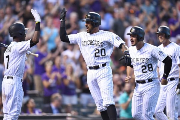 Ian Desmond's three-run homer helped the Rockies beat the Giants. (Ron Chenoy/USA Today Sports)