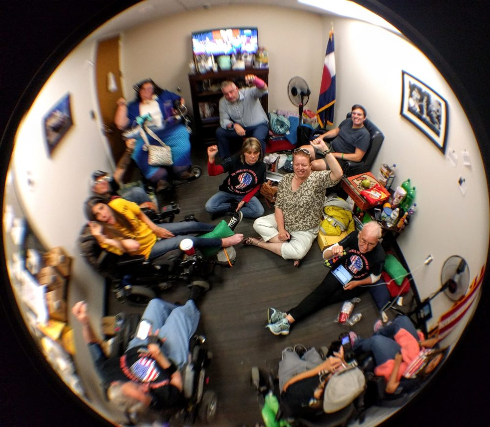 Sen. Cory Gardner's office during a protest. (Kevin J. Beaty/Denverite)