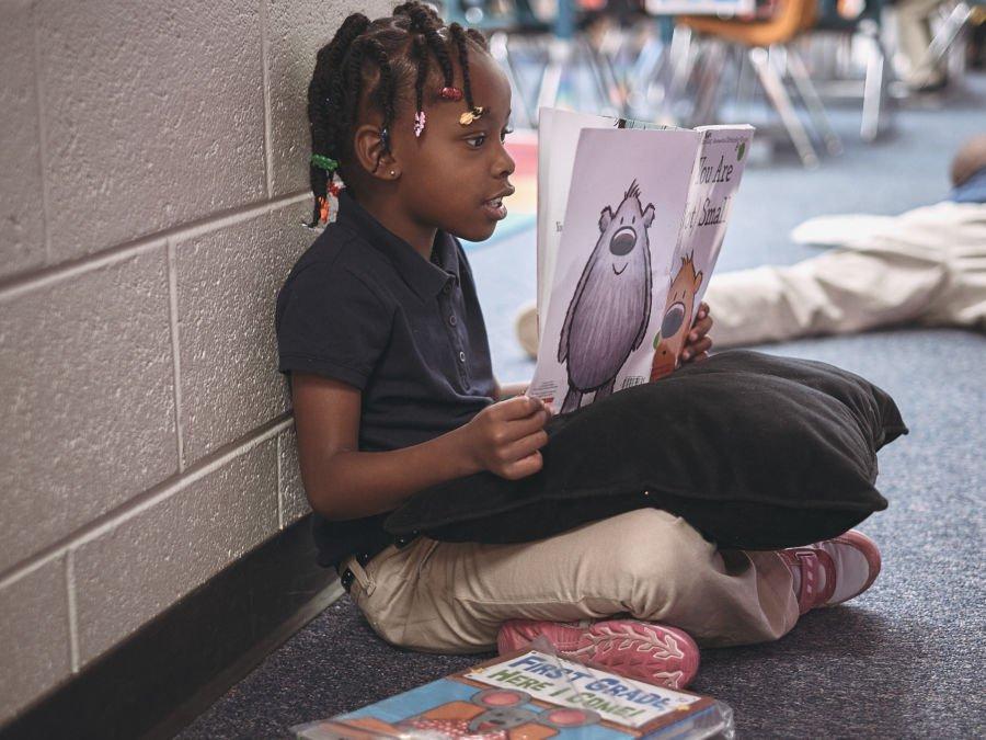 A McGlone first-grader practices her reading. (Roy Barnett/McGlone)