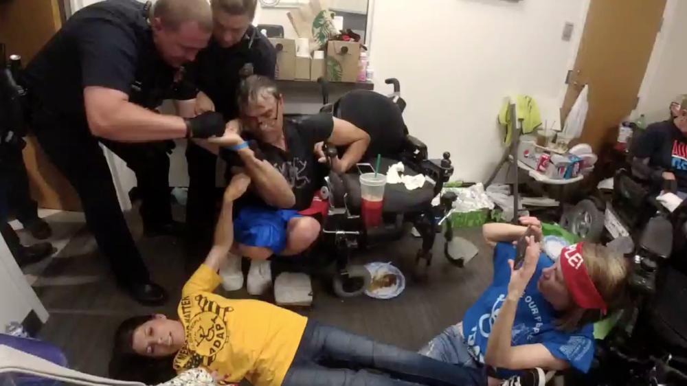 Denver police arrest protesters inside Cory Gardner's office. June 29, 2017.