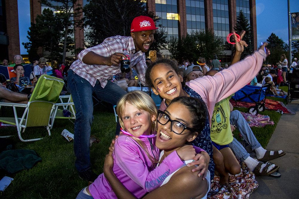 Juste (top to bottom), Savannah, Bella and Aubrey pose for a portrait. The Glendale 4th of July fireworks show, July 1, 2017. (Kevin J. Beaty/Denverite)  denver; colorado; kevinjbeaty; denverite; fourth of july; 4th of july; july 4th; july fourth; independence day; glendale; fireworks