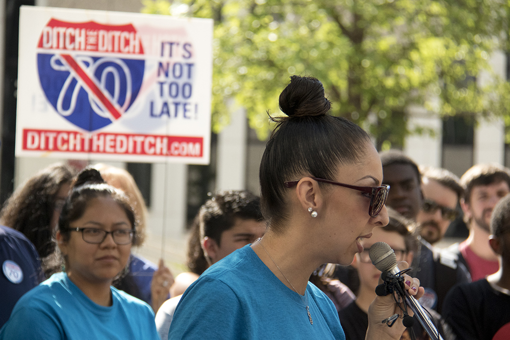 """Candi CdeBaca. """"Ditch the Ditch"""" activists announce a new lawsuit challenging the I-70 expansion outside the Alfred A. Arraj United States Federal Courthouse, July 10, 2017. (Kevin J. Beaty/Denverite)  i-70; i70; ditch the ditch; denver; colorado; denverite; lawsuit; kevinjbeaty;"""