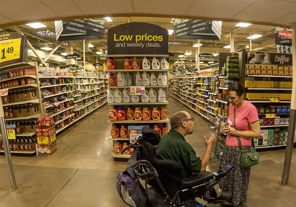 Aaron Walbert goes to King Soopers on 9th Avenue with his caretaker, Jennifer Hill, July 11, 2017. (Kevin J. Beaty/Denverite)  aaron walbert; denver; denverite; colorado; kevinjbeaty;