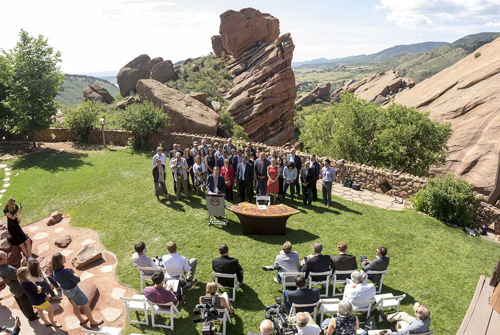 Governor John Hickenlooper holds a press conference about positioning Colorado to adhere to Paris Climate Agreement standards with or without the federal government. July 11, 2017. (Kevin J. Beaty/Denverite)denver; colorado; energy; red rocks; governor john hickenlooper; kevinjbeaty; denverite;
