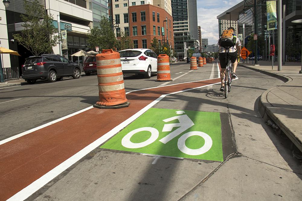 A protected bike lane on 14th Street. (Kevin J. Beaty/Denverite)  denver; colorado; denverite; kevinjbeaty; downtown; central business district; bike lane;