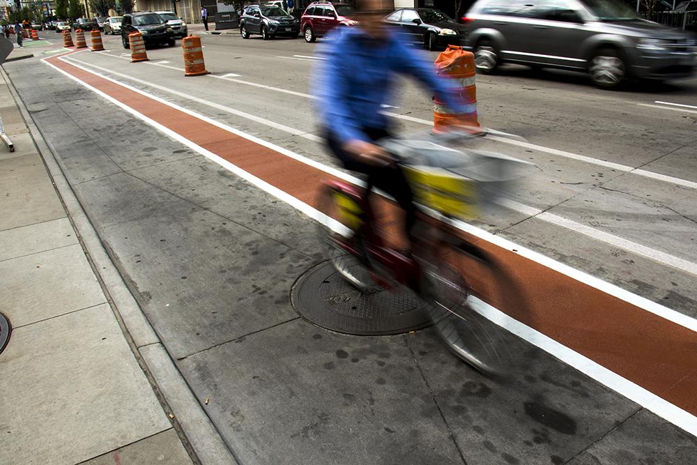 A protected bike lane on 14th Street. (Kevin J. Beaty/Denverite)