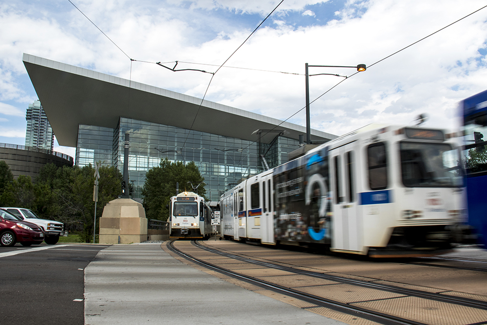 An RTD train crosses Speer Boulevard by the Convention Center. (Kevin J. Beaty/Denverite)