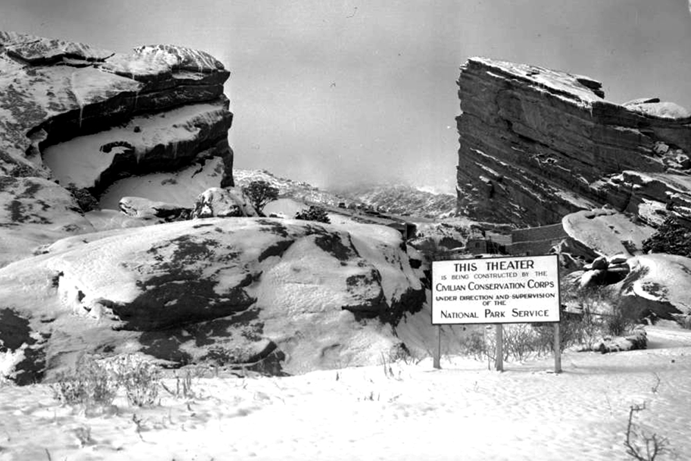 View of a sign near the unfinished Red Rocks Amphitheater in Red Rocks Park. (Denver Public Library/Western History Collection/Z-8810)  red rocks; civilian conservation corps; archive; denver; colorado; kevinjbeaty;