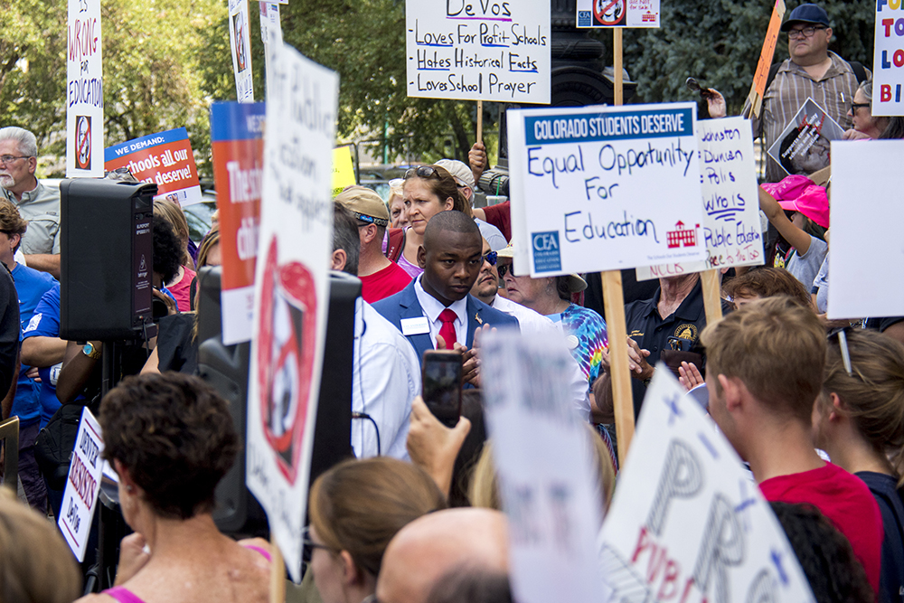 Denver School Board contender Tay Anderson at a protest against U.S. Secretary of Education Betsy DeVos, who is scheduled to speak at an American Legislative Exchange Council this week. July 19, 2017. (Kevin J. Beaty/Denverite)  denver; colorado; denverite; kevinjbeaty; betsy devos; copolitics; protest; capitol; education;