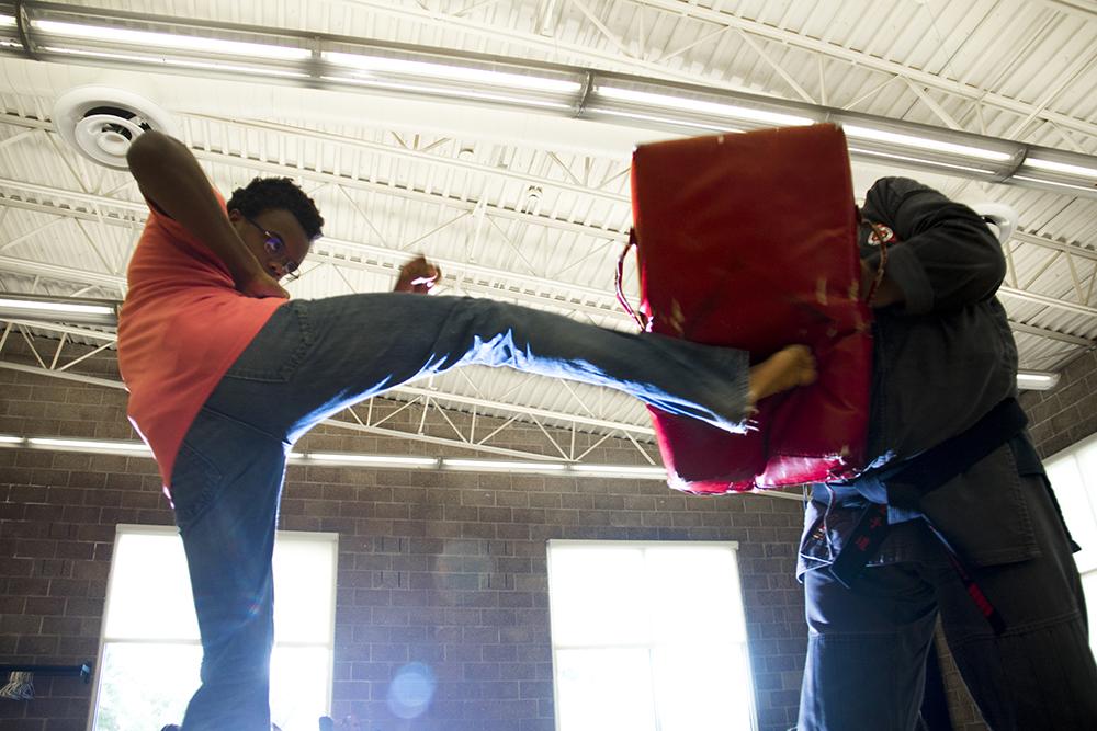14-year-old Jayden trains with Sensei Mark Dudney. Karate class at the Cook Park rec center, July 19, 2017. (Kevin J. Beaty/Denverite)  karate; mydenver card; rec center; cook park; virginia village; denver; colorado; denverite; kevinjbeaty;