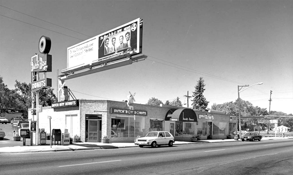 View of a Dutch Boy Donuts store at 6622-40 East Colfax Avenue (corner Niagara Street) in the South Park Hill Neighborhood of Denver, Colorado, June 1990. (Roger Whitacre/Denver Public Library/Western History Collection/Z-10637)  colfax; denver; colorado;
