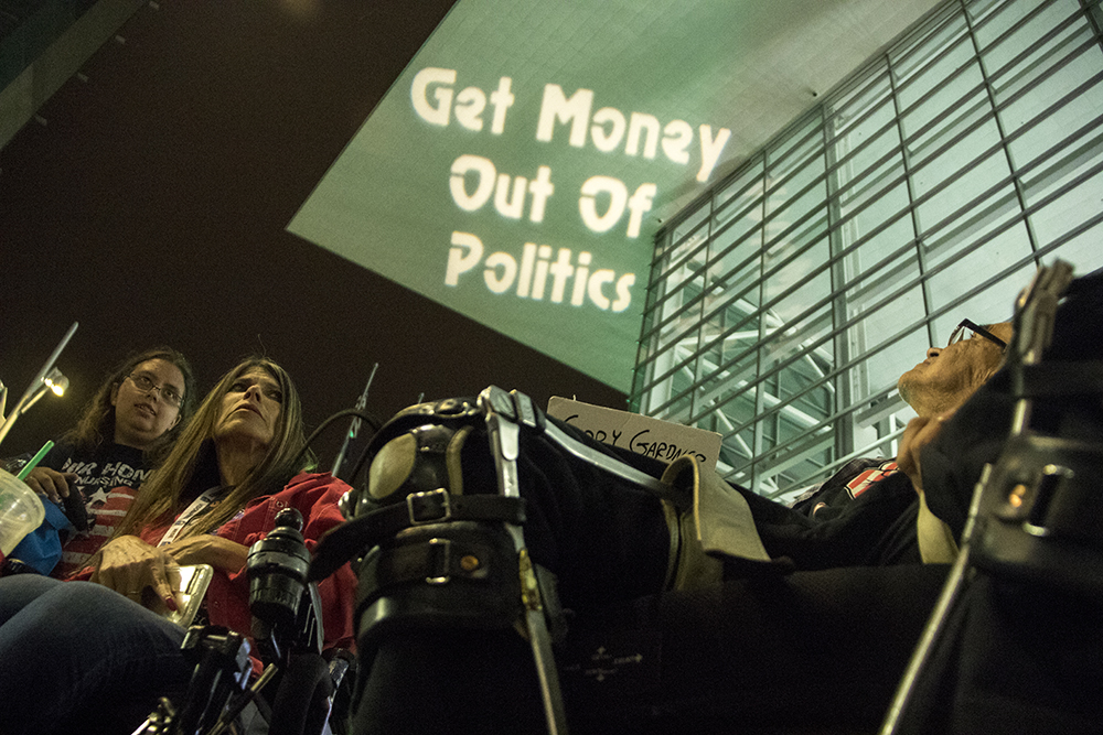 Jacqueline Mitchell (left to right) Dawn Russell and LB Smith protest outside the Colorado Convention Center after interrupting the Western Conservative Summit, July 21, 2017. (Kevin J. Beaty/Denverite)  western conservative summit; wcs; protest; cory gardner; healthcare; adapt; medicaid; denver; denverite; kevinjbeaty;