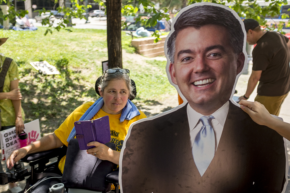 Julie Reiskin, of ADAPT and the Colorado Cross-Disability Coalition, during an ADAPT protest against yet another healthcare bill in Washington that could strip Medicaid coverage. Skyline Park, July 27, 2017. (Kevin J. Beaty/Denverite)  adapt; healthcare; denver; colorado; denverite; skyline park; medicaid; kevinjbeaty;