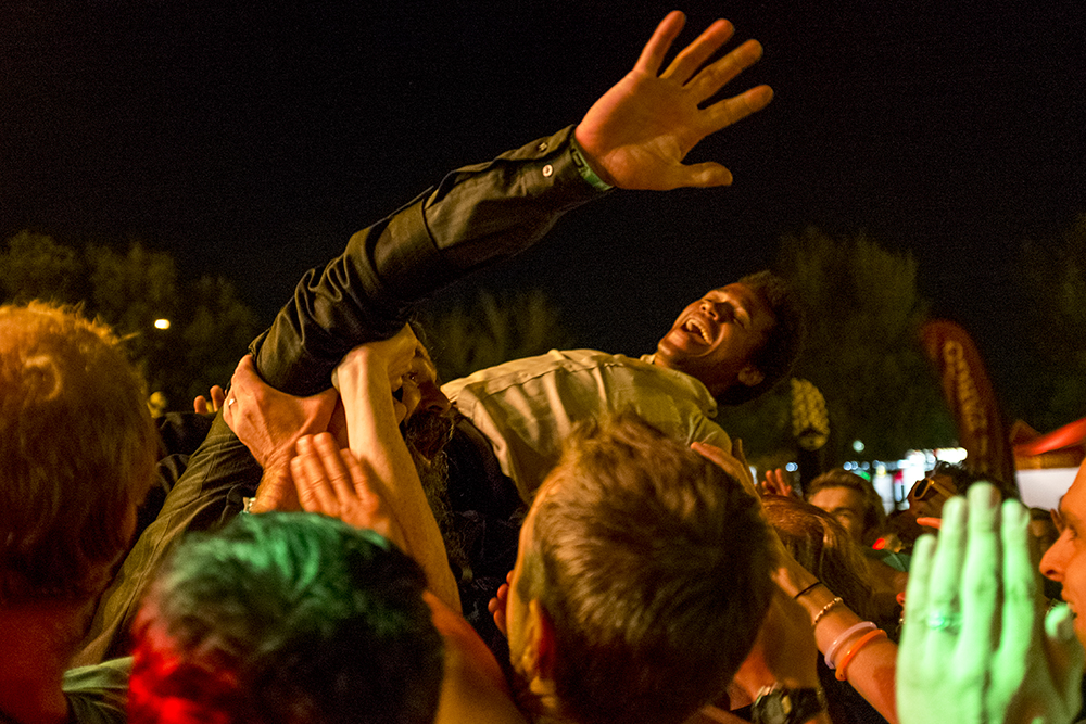 Benjamin Booker crowdsurfs during his performance closing the the Underground Music Showcase's main stage, July 31, 2017. (Kevin J. Beaty/Denverite)