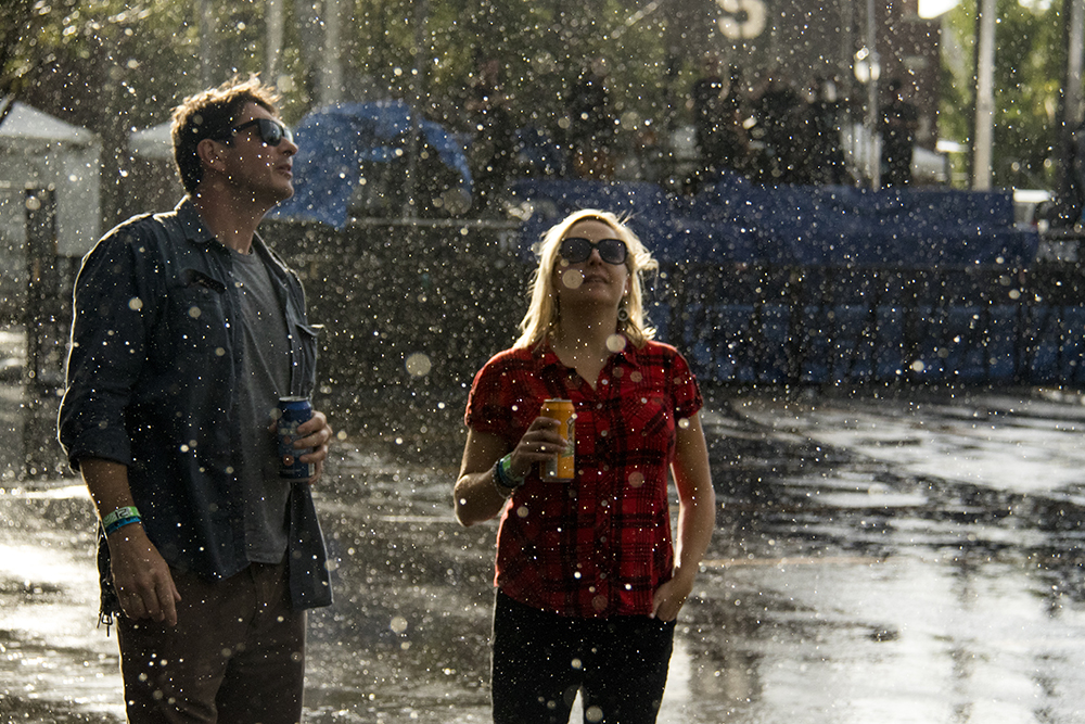 An afternoon drizzles breaks into a full-on deluge at the Underground Music Showcase's main stage, July 31, 2017. (Kevin J. Beaty/Denverite)  denver; ums; denverite; colorado; music; south broadway; bars; nightlife; entertainment; rain; cowx; weather;