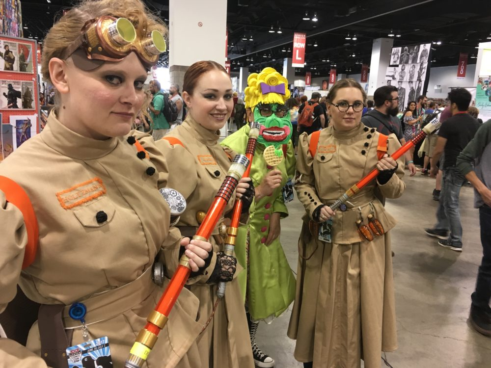Morgan Gray, Kelsie Broemarkle, Kim Gray and Lauren Gray pose in their Ghostbusters costumes at Denver Comic Con on Saturday, July 1, 2017. (Dave Burdick/Denverite)