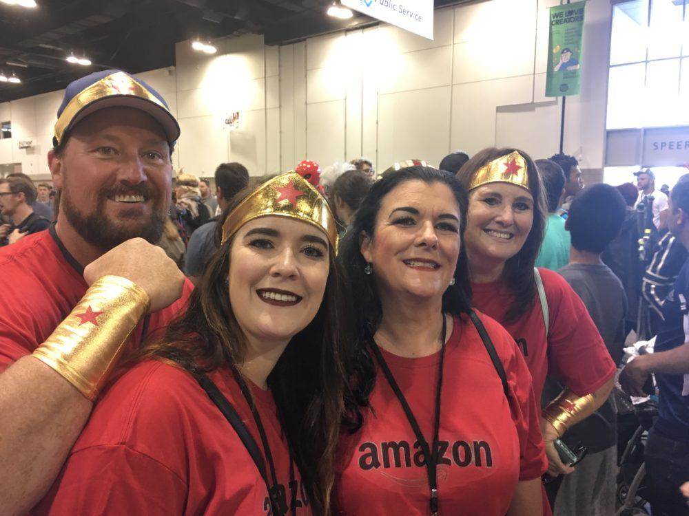 Dan Bower, Brianna Bower, Kim Bower and Melanie Morrefield, dressed as Wonder Women, pose at Denver Comic Con on Saturday, July 1, 2017. (Dave Burdick/Denverite)