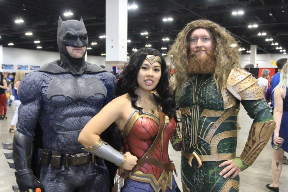 Diana Lee, dressed as Wonder Woman, poses at Denver Comic Con with David Summers (left) and Derrick McMullen (right) on Saturday, July 1, 2017. (Stephanie Snyder/Denverite)