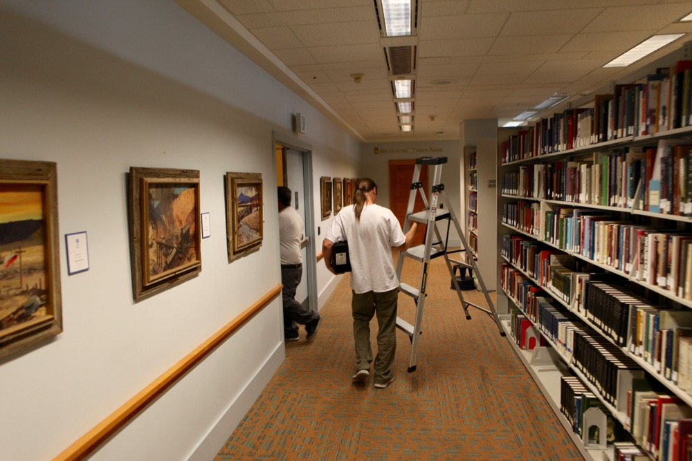 Michael Brodsky carries a ladder through the Denver Public Library (Andrew Kenney/Denverite) Denver Day Works
