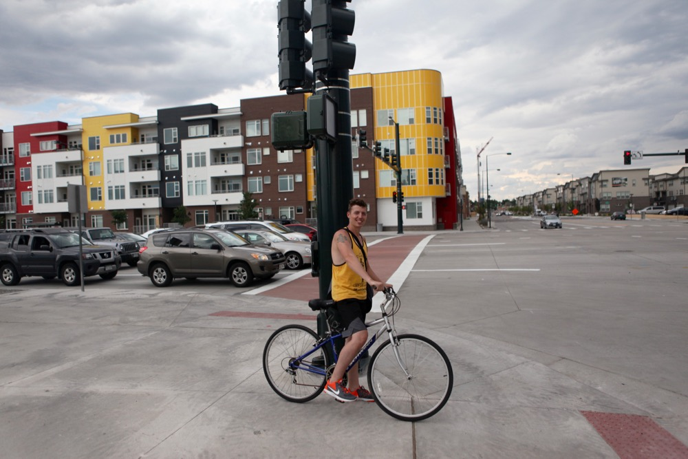 Alex Howard, 29, has been biking since he moved to the Interstate 25 and South Broadway area several days ago. (Andrew Kenney/Denverite)