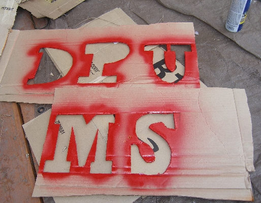 Sign-making for the UMS. (Photo: John Moore)