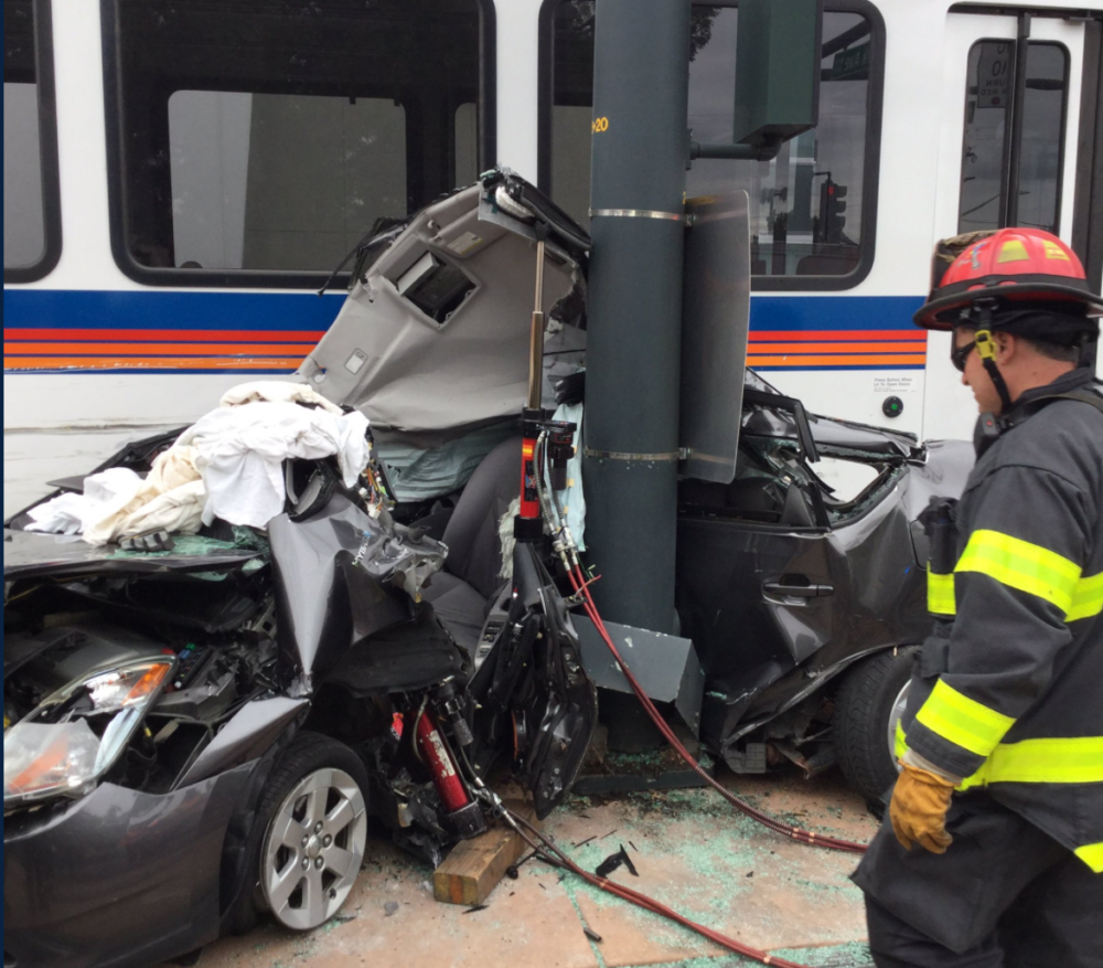 The crash that pinned a car against a pole. (Denver Fire Department)