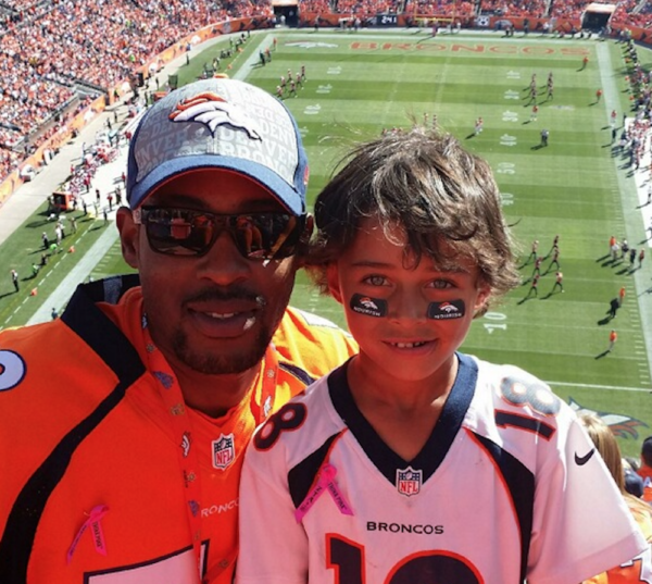 Marquette Beasley and his son at a Broncos game. (Courtesy of Marquette Beasley)